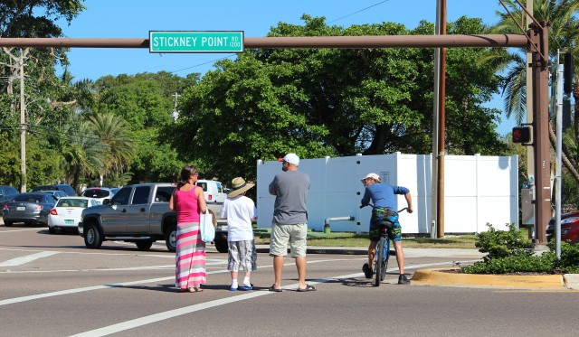 Pedestrians and a cyclist stop mid-crossing of Stickney Point Road as traffic turns right onto Midnight Pass Road. Photo by Rachel Hackney