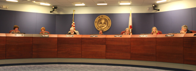 The Sarasota County School Board sits in session on Sept. 15 with board attorney Art Hardy at the far right. Chairman Frank Kovach is at the center of the dais. Photo by Rachel Hackney