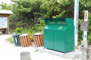 A combination garbage/recycling receptacle stood at Beach Access 5 on Siesta Key in the spring of 2014, next to signage about county park rules. Photo from the News Leader archive