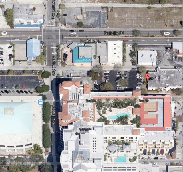 A flag in this aerial view shows the site of the former United Way building in downtown Sarasota. Image from Google Maps
