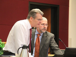 Howard Berna (right) assists Attorney William Merrill with the visual equipment before the meeting. Rachel Hackney photo