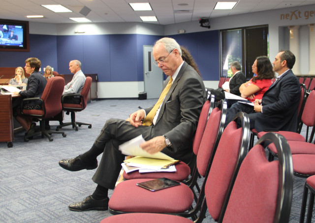Pat Neal of Neal Communities (front row) and County Commissioner Paul Caragiulo (behind Neal) listen to board workshop discussion on Oct. 20. Rachel Hackney photo