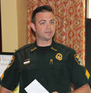 Sgt. Jason Mruczek addresses Siesta Key Association members. Rachel Hackney photo