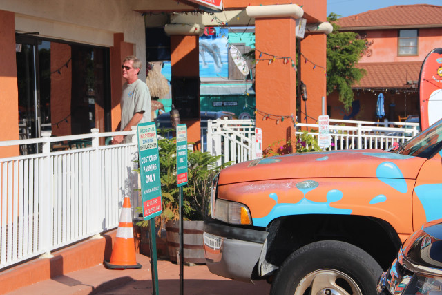 Signs in front of Key Corners businesses fronting Ocean Boulevard name businesses in the plaza. Rachel Hackney photo