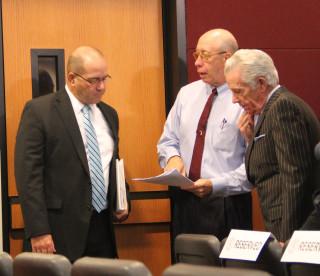 Tom Harmer, Tom Barwin and Doug Logan talk informally before the start of the Nov. 6 special meeting. File photo