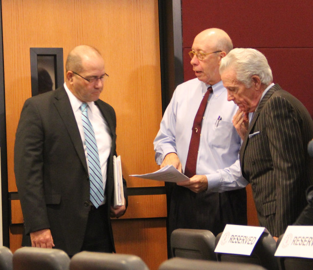 Tom Harmer, Tom Barwin and Doug Logan talk informally before the start of the Nov. 6 special meeting. Rachel Hackney photo