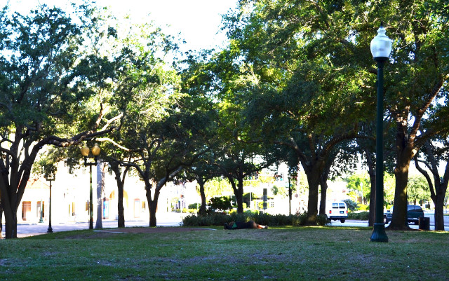 A homeless man sleeps in Five Points Park. File photo