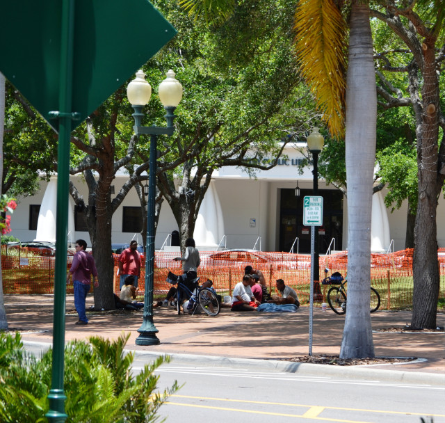 When Five Points Park was roped-off for improvements in 2013, homeless people gathered outside the protective fencing. File photo