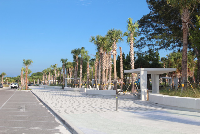 New concrete picnic shelters stand adjacent to the promenade at Siesta Public Beach. Rachel Hackney photo