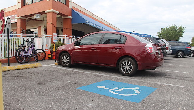 A handicapped parking sign is missing from one Key Corners space. Rachel Hackney photo
