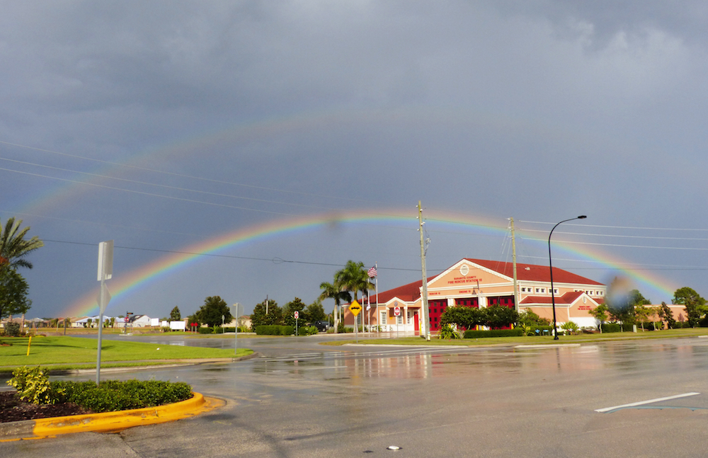 The fire station on Honore Road is framed in a late day rainbow.