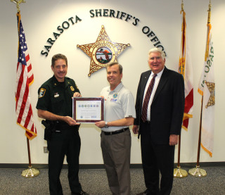 Col. Kurt Hoffman of the Sheriff's Office accepts the Seven Seals Award from ESGR committee members Tony Conboy and David McCormick. Contributed photo