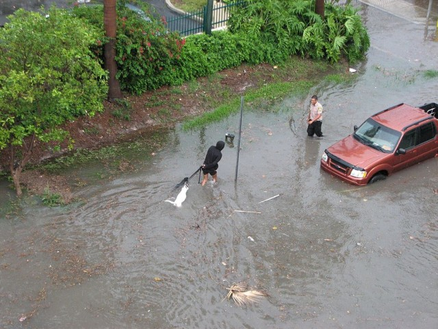 A South Beach street in Miami is flooded in 2009. Photo by maxstrz via Wikimedia