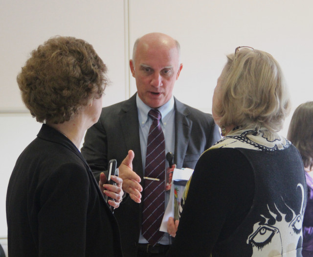 (From left) Superintendent Lori White, Deputy Superintendent Scott Lempe and School Board Chair Shirley Brown confer after the Convocation. Rachel Hackney photo