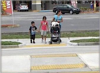 Refuge islands are designed to make it safer for pedestrians to cross busy roads. Image courtesy FDOT
