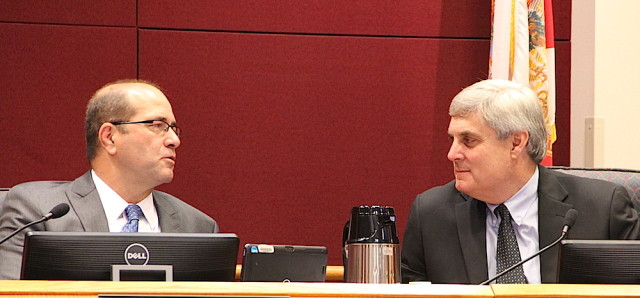 County Administrator Tom Harmer talks with County Attorney Stephen DeMarsh. Rachel Hackney photo