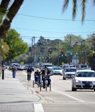 Amish bicyclists head down Bahia Vista Street. File photo