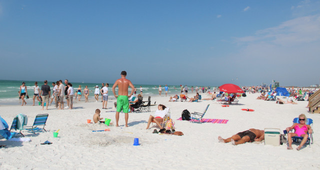 Tourists make themselves at home on Siesta Public Beach. File photo