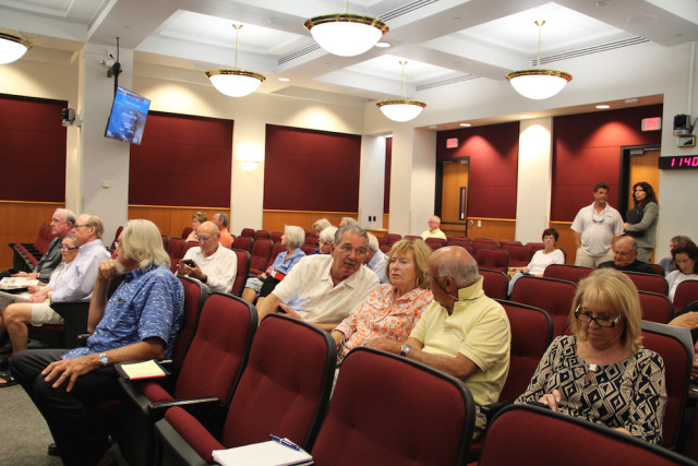 The Commission Chambers begins filling up before the start of the meeting. Rachel Hackney photo