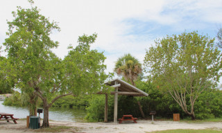 A picnic shelter stands by a canal at Turtle Beach Park. File photo