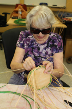 Bona Lee enjoys the Basket Weaving for the Visually Impaired class offered by Adult and Community Enrichment. Contributed photo