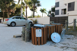 Recycling bins stand at Beach Access 5 just outside Siesta Village. File photo