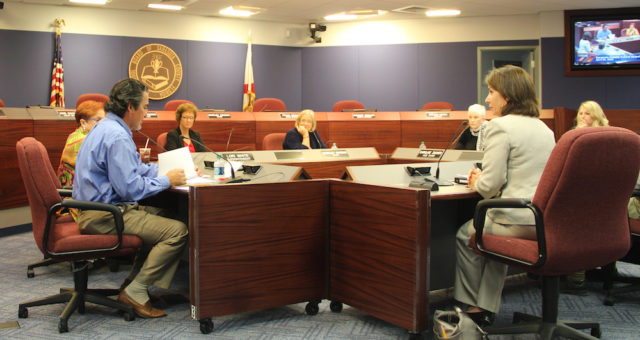 Mary Dougherty-Slapp (right) talks with the School Board members on April 19. Rachel Hackney photo