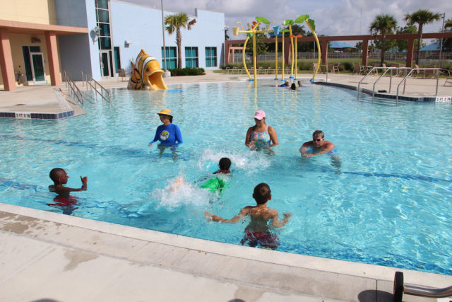Melon Dash, CEO of the Miracle Swimming program based in Sarasota (left, in the water) leads a youth swimming instruction class in the Robert Taylor Complex pool in 2013. File photo