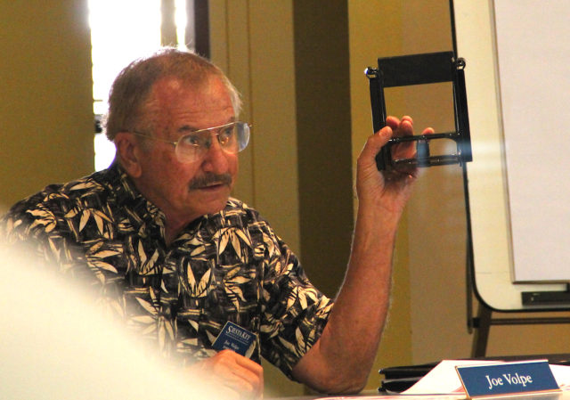 Joe Volpe holds up the type of container the SKA plans to use. Rachel Hackney photo