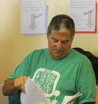 Michael Shay looks through a folder before the start of the June 2 SKA meeting. Rachel Hackney photo