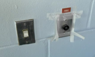 Tape holds a panic button to the wall in one section of the jail. Image courtesy Sheriff's Office