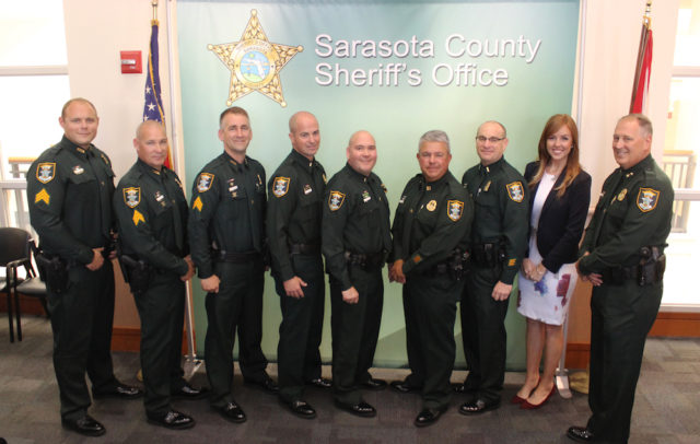 (From left) Sgts. Matt Tuggle, Gregory Cramer and James Darby, Lts. Bryan Ivings and Donny Kennard, Capt. Tim Enos, Lt. Brian Gregory, Community Affairs Director Kaitlyn Johnston and Sheriff Tom Knight. Contributed photo