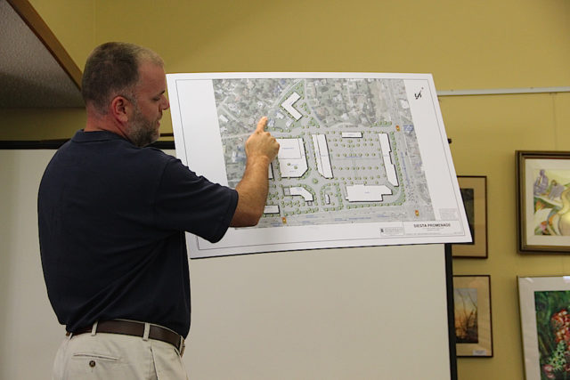 Todd Mathes explains the placement of retail and residential structures on the site. Rachel Hackney photo
