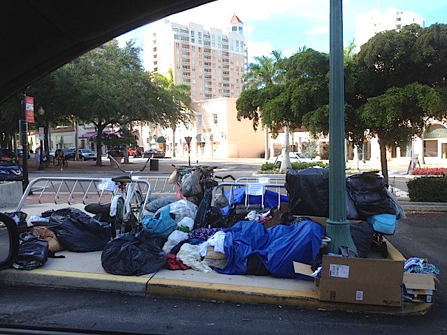 """A resident emailed this photo to City Commissioner Liz Alpert on July 1; it was taken at Selby Library. In a July 18 email to Alpert and the resident, City Manager Tom Barwin wrote, """"Beginning today we are told that the Sarasota County managed Selby Library will be implementing new rules regarding the storage of possessions at the library and better address public safety and sanitation conditions at the Library. I suspect the new county library rules will help address the crisis at the library but will push the challenge somewhere else."""" Image courtesy City of Sarasota"""