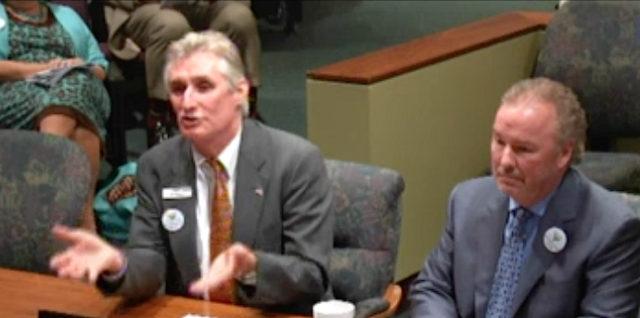 Jon Thaxton (left) and Michael Klauber address the City Commission. News Leader photo