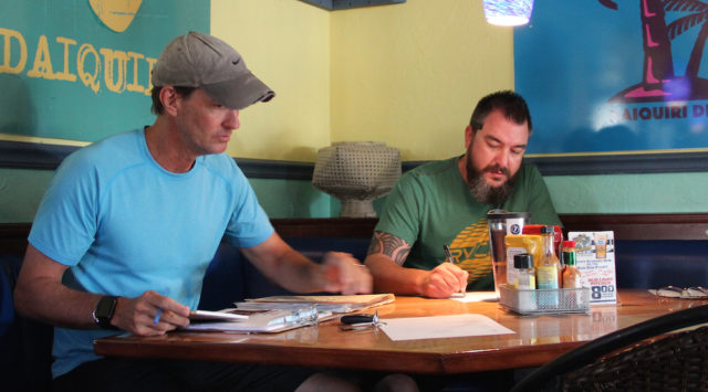 Russell Matthes (left) and Wendall Jacobsen prepare for the start of the meeting. Rachel Hackney photo