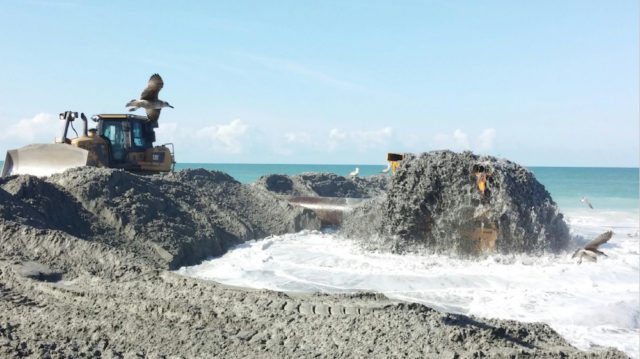 Sand piped ashore was moved into place by bulldozers. Image courtesy Sarasota County