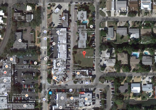 An aerial map shows the site of the proposed project: a vacant lot in Siesta Village. Image from Google Maps