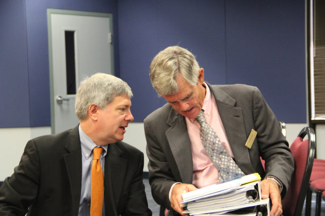 Art Hardy (left) talks with consultant Bill Vogel after the discussion with the School Board. Rachel Hackney photo