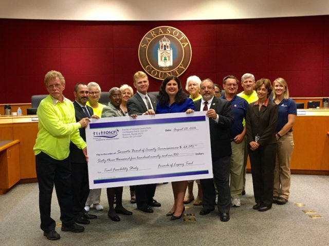 Members of Friends of The Legacy Trail and Friends of Sarasota County Parks join the County Commission for the check presentation. Photo courtesy Sarasota County
