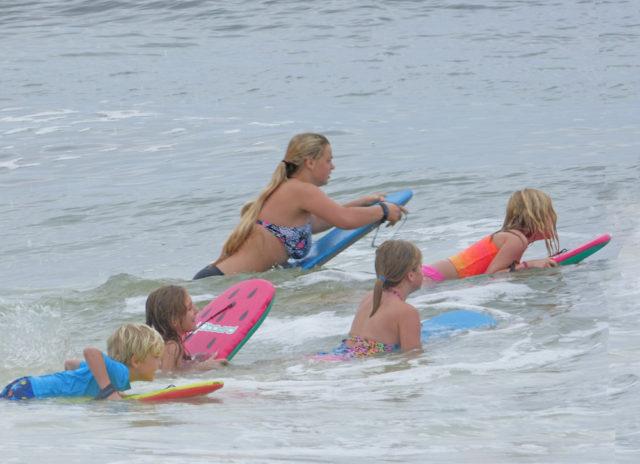 Visitors to Nokomis Beach take to the waves. Photo by Fran Palmeri