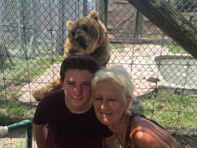 Skyler and his grandmother pose with one of the well known residents of Big Cat Habitat. Photo courtesy of Steve Wall