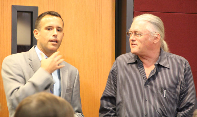 Matt Osterhoudt (left) speaks with Jono Miller before the hearing begins on Oct. 25. Rachel Hackney photo
