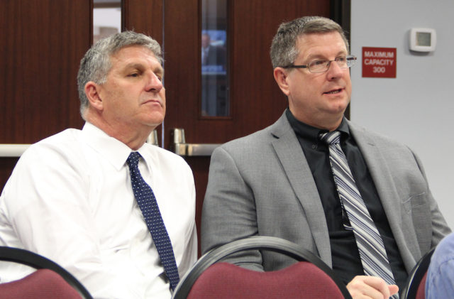 Steve Cantees (left), the district's executive director of high schools, and Sarasota High Principal David Jones listen to discussion on Oct. 18. Rachel Hackney photo