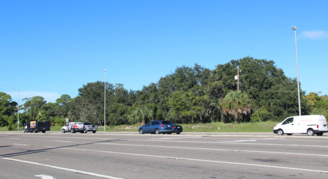 Traffic flows west on Stickney Point Road past the Siesta Promenade site early on an October morning. Rachel Hackney photo