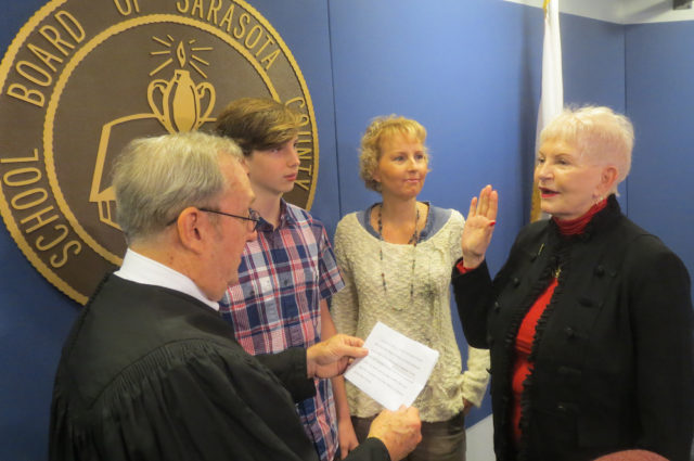 Caroline Zucker (right) is sworn in by retired Judge Lee Haworth. Joining her are grandson Colin Leonard and daughter Liza Leonard. Contributed photo