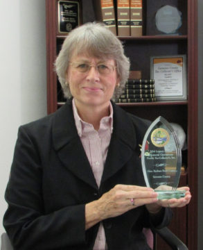 Sarasota County Tax Collector Barbara Ford-Coates holds the award she recently received from a state organization. Contributed photo