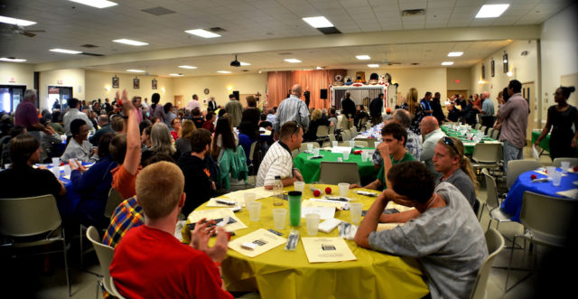 Attendees enjoy the Thanksgiving dinner in 2013. File photo