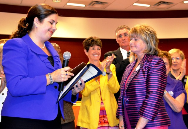 Sarasota County Commission Commissioner Christine Robinson reads a proclamation to Sarabeth Kalajian, director of the county's library system, in 2012. File photo