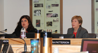 Vice Chairwoman Christine Robinson (left) and Commissioner Nora Patterson view slides about the Lido project on June 30. File photo